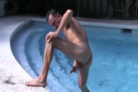 brunette hair guy Strokes His large knob In The Pool