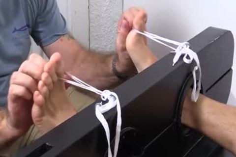 Hunky Dane gets The Tickle Brush Treatment For His kinky Feet